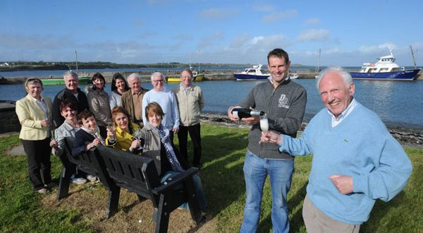 Cillian Murphy (second right), chairman of Loop Head Tourism, celebrates with John Williams and fellow group members in Carrigaholt following the announcement that the Loop Head Peninsula has been voted Best Place to Holiday in Ireland by readers of The Irish Times. Photograph by Declan Monaghan