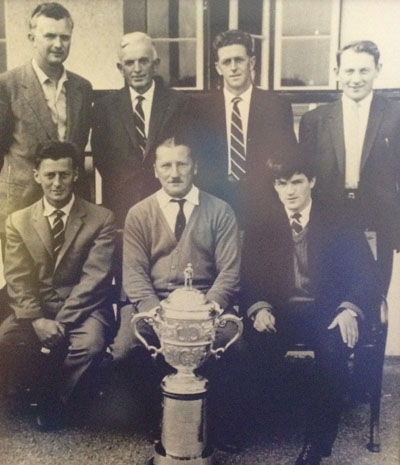The Lahinch team from 1963: (Back) Jack Wall, TG O'Donnell (president), Frank Lehane, Jack O'Callaghan; (Front) Brendan Vaughan, Justice JG Hurley (non playing captain) and Michael Rush.