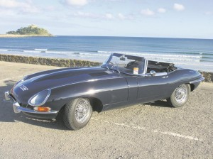 The gorgeous E-Type with St Michael's Mount in the background.