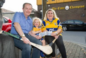 John Galvin, general manager the Clare Champion presents Louise Dunworth of Tulla and her son Harry (2) with a pair of tickets fro the All-Ireland hurling final replay in Croke park, first prize in the recent Clare Champion facebook competition. Photograph by John Kelly.