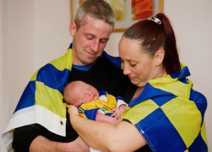 Mark and Laura Hinsley of Dun an Oir, Shannon with their newborn baby Shane, who they are naming after Clare hurling hero Shane O'Donnell.  Photograph by John Kelly
