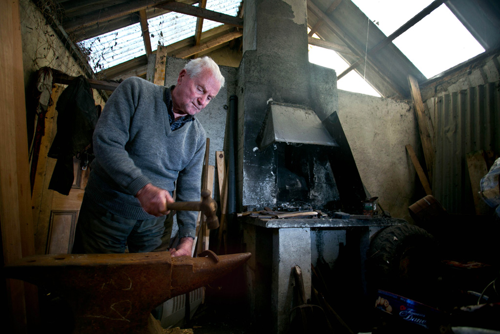 Blacksmith Tom Whelan in his forge in O'Dea's Road, Kilrush. Photograph by Arthur Ellis