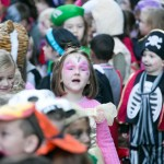 4 year old Aisling O'Connell, a Senior infant from Ennis National School chants for pumpkins during the annual Ennis National School Hallowe'en Hobble