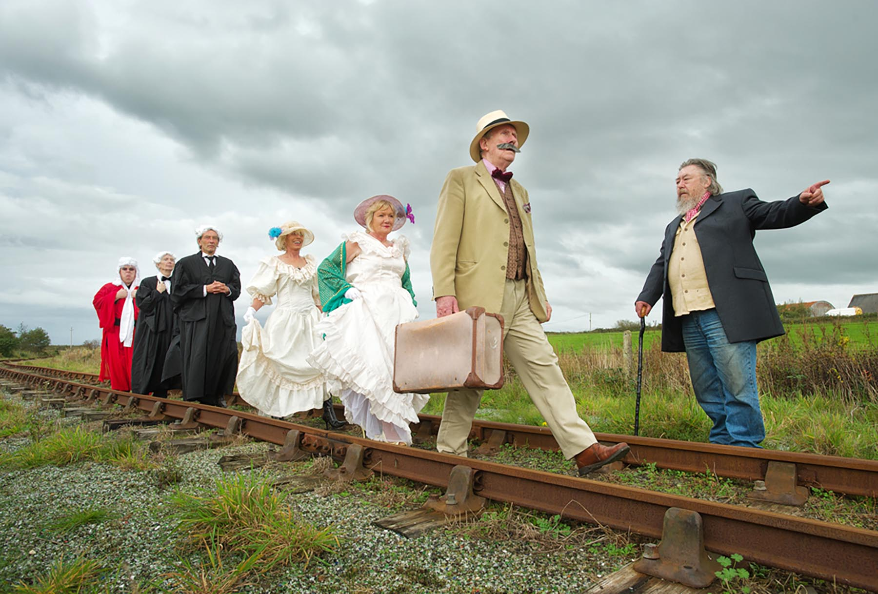 On the right track: Members of the Junk Shun Productions in their Laughter In Court costumes at a photocall in Moyasta Junction to promote the Kilkee Playwright Festival, which runs on November 1 and 2.  From front to rear;  Richard Gair, manager West Clare railway, as Mr Sullivan, Charles Clancy as Percy French, Theresa Hartigan and Margaret Whelan as Miss Malone A and Miss Malone B,  Paul Clegg as Clerk, Brian Comerford as QC Murphy, and Jim McNamara as Judge Kelly.  Photograph by John Kelly