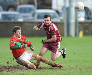 Padraig Greene of Kilmurry Ibrickane in action against Niall Meere of Lissycasey during their Minor Division One county football final at Cooraclare. Photograph by John Kelly.