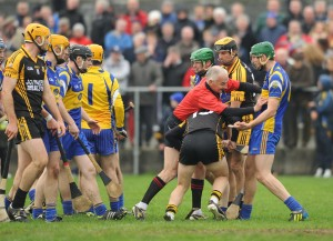 Referee Ambrose Heagney gets stuck in between sparring Newmarket and Ballyea players during the the closing stages of their semi-final at Clarecastle. Photograph by John Kelly.