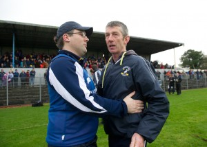 Na Piarsaigh manager and Sixmilebridge native Sean Stack is congratulated by Sixmilebridge manager John O Meara at the final whistle following the Munster Club Championship final at Cusack park. Photograph by John Kelly.