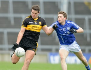 Eoin Brosnan of Dr. Crokes in action against Cathal Mc Inerney of Cratloe during their Munster club football final at The Gaelic Grounds. Photograph by John Kelly.