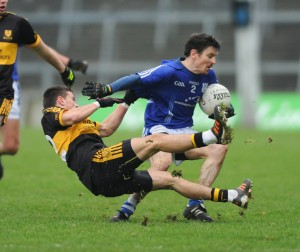 Sean Chaplin of Cratloe in action against Brian Looney of Dr. Crokes during their Munster club football final at The Gaelic Grounds. Photograph by John Kelly.
