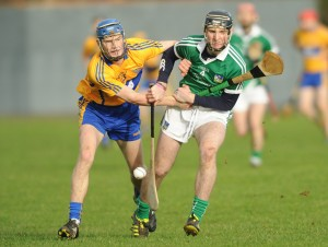 Bobby Duggan of Clare in action against Richie English of Limerick during the Waterford Crystal quarter final at Sixmilebridge. Photograph by John Kelly.