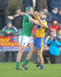 Stephen Walsh of Limerick in action against David Reidy of Clare during the Waterford Crystal quarter final at Sixmilebridge. Photograph by John Kelly.