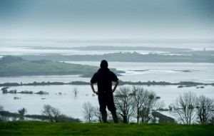 Paul O'Sullivan of Cooga, Kildysart, looking out over farms which which were covered by  flood water from the Shannon Estuary a few weeks ago. Photograph by John Kelly