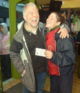 Answered prayers - Nora Murphy from Kilkishen receives the first Garth Brooks tickets sold in Ennis this morning from Dave Woodford, The Irish Shop.