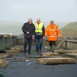 County manager Tom Coughlan; engineer Tom Tiernan and  local business man Odran O'Looney  view  the storm damage at Lahinch promenade. Photograph by John Kelly.