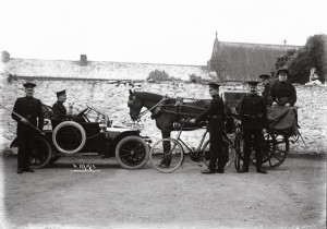 At the RIC Barracks at Sixmilebridge in 1912 were District Inspector George D'Urban Rodwell, with the Head Constable Michael Tobin in the side car. Behind Tobin is Sergeant O'Sullivan.  The RIC man holding the carbine alongside Rodwell is Constable McLoughlin. Constable  Gleeson stands with the bicycle. The constable on the right facing the camera is unidentified.    With the permission of Patricia Haselbeck Flynn, copyright the Haselbeck Collection