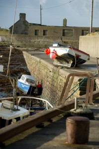 A view of  a boat which was lifted up onto the pier at Seafield, Quilty during the storm. Photograph by John Kelly.