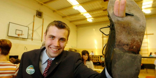 Councillor Cathal Crowe makes the victory sign through the worn-out sole of his shoes after the 2004 Local Elections.