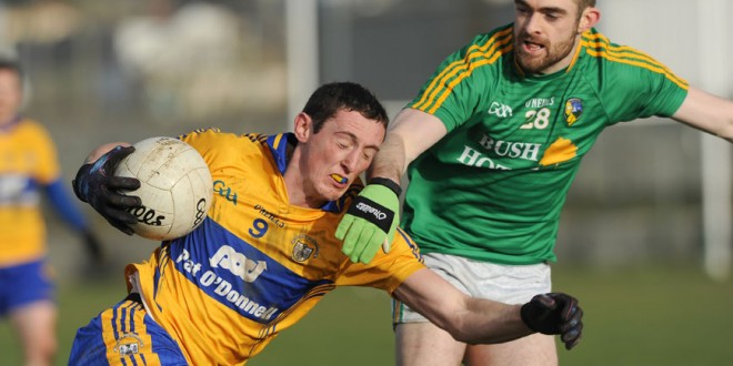 Cathal O'Connor tries to get past Leitrim's Shane Moran during their Round 2 Division 4 National Football League game at Miltown Malbay.