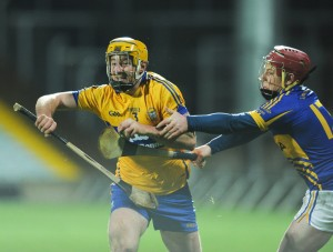 Cian Dillon of Clare in action against Kieran Morris of Tipperary during their Waterford Crystal Final at The Gaelic Grounds. Photograph by John Kelly.