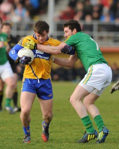 Sean Collins of Clare in action against Wayne McKeon of Leitrim during their Round 2 Division 4 national Football League game at Miltown Malbay. Photograph by John Kelly.