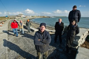 Timmy Dooley TD with Kilbaha locals including, local business man Bernie Keating, front, Cillian Murphy of Loop Head Tourism, Alan Mitchell, resident, Ger Crotty, local farmer, Seamus Connolly, sculptor, and Patrick Blake, dairy farmer who are opposed to Clare County Council's decision to close an 80m stretch of road in the village. Photograph by John Kelly.