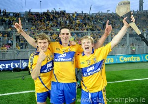 Shane O'Donnell, Brendan Bugler and Podge Collins  celebrate after the All-Ireland replay win over Cork at Croke Park. Photograph by John Kelly.