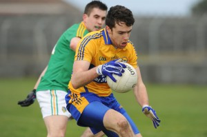 Shane Brennan under pressure from Paddy Maguirein their Division 4 National Football League game at Miltown Malbay.