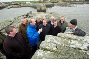 Minister Simon Coveney with local fishermen, elected representatives and election candidates at Doolin Pier. Photograph by John Kellly