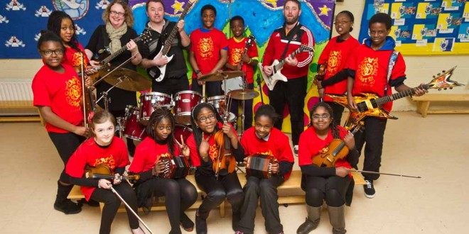 A group of Scoil Chriost Ri, Cloughleigh, Ennis, pupils who have been short listed for the finals of the Comortas Amhran Naisunta at the National Pan Celtic finals in Carlow on Saturday night. Front from left; Lauren Cusack, Zarena Boladale, Rebecca Sobamiwa, Emma Ikiebey and Deborah Babajide. Back from left; Glodia Luyinduladio, Chelsea Mba Ileozor, Karen Vaughan and Joe Garry, teachers, Abdul Saidi, Roy Jones Mbou, Paul Crehan, teacher, Axelle Hakizimana and Dereck Sholarin. Missing from photo are; Leah Fawl and Emmanuel Ikiebey. Photograph by John Kelly.