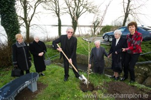 Bishop of Galway Martin Drennan planting a tree at the official opening of the new wing and other renovations at Seamount College, Kinvarra watched by Syl Feeney, a sister of the late Sr Pius to whom a seat was dedicated, Sr Caoimhin, former teacher; Canon Frank Larkin, PP, Sr Berchmans and Geraldine Connors, deputy principal. Photograph by John Kelly.