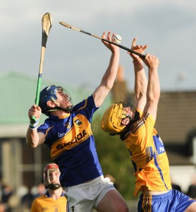 Michael Dunne of Tipperary in action against Ciaran Cooney and Seamus Downey of Clare during their Munster Minor Championship game at Cusack Park. Photograph by John Kelly.