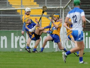 Jason Loughnane of Clare blocks a double attack at goal helped by Seamus Downey and Darragh Walsh during their Munster Minor hurling Championship game against Waterford at Cusack park. Photograph by John Kelly.