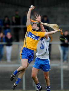 Brian Guilfoyle of Clare in action against David Prendergast of Waterford during their Munster Minor hurling Championship game at Cusack park. Photograph by John Kelly.