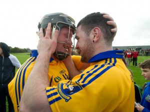 Sixmilebridge players Jamie Shanahan and Brian Carey share a moment of celebration together on the pitch following the win over Ballyea in the U-21 championship final at Clarecastle. Photograph by John Kelly