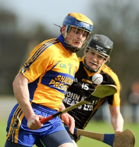 Seadna Morey of Sixmilebridge in action against Pearse Lillis of Ballyea during the U-21 championship final at Clarecastle. Photograph by John Kelly