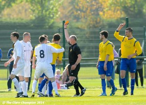 Referee Oliver Falsey sends off  of AUL Dublin in action against XX of Clare League during the Oscar Traynor Trophy Final at AUL Complex, Clonshaugh, Dublin. Photograph by John Kelly.