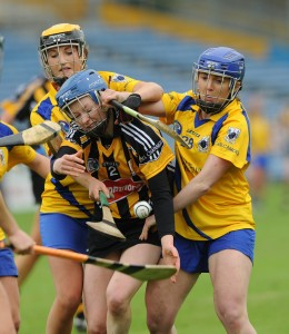 Mairead Power of Kilkenny in action against Ellen Horgan and Claire Mc Mahon of Clare during their Division 1 National League Camogie Final in Thurles. Photograph by John Kelly.