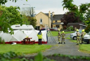 Gardai and emergency personnel on the scene at a camp site in Corofin where a body was discovered. Photograph by John Kelly.l