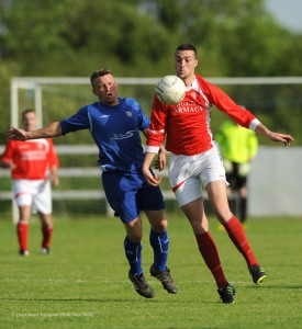 Adrian Walsh of Ennis Town A in action against Steven Kelly of Newmarket Celtic A during the Clare Cup final at the County Grounds. Photograph by John Kelly.