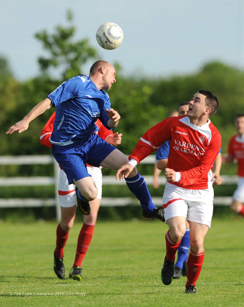 Jason White of Ennis Town A in action against Eoin Hayes of Newmarket Celtic A during the Clare Cup final at the County Grounds. Photograph by John Kelly.
