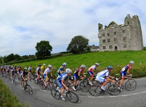 A general view of the action as the peloton pass the ruins of Leamaneh Castle during Stage 4 on the 2013 Junior Tour of Ireland. Picture credit: Stephen McMahon / SPORTSFILE