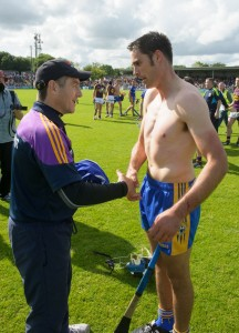 Wexford manager Liam Dunne gets Brendan Bugler's jersey from him following their All-Ireland qualifier game at Cusack Park. Photograph by John Kelly