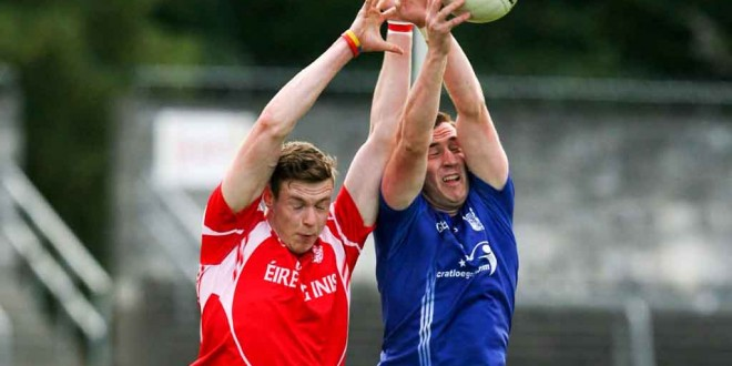 Cratloe's Cillian Duggan battles with Eire Og's Darren O'Neill during their Senior Football game at Cusack park Ennis on Saturday evening. Pic Arthur Ellis.
