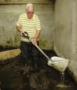 Jimmy Quinn in his flooded garage. Photograph by John Kelly.