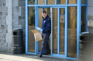 A Crime Scene Investigation Garda exits the scene at Ennis Courthouse. Photograph by John Kelly