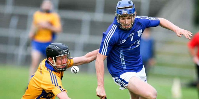Cratloe's Podge Collins battles with Sixmilebridges Tadgh Keogh during their Senior Hurling Championship game at Cusack Park Ennis on saturday.