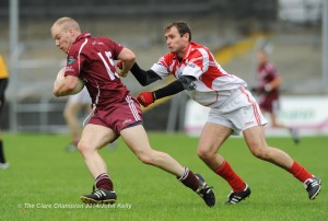 Niall Kelly of Lissycasey in action against Sean O Meara of Eire Og during their senior championship game in Cusack park. Photograph by John Kelly.