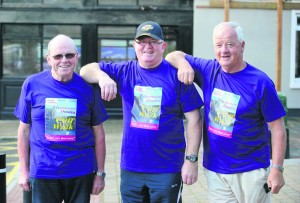 Pat Lynch, Gerry Mc Mahon and Kevin O Loughlin about to catch the bus for the Weightwatchers/Clare Champion Liscannor to Cliffs of Moher coastal walk. Photograph by John Kelly.