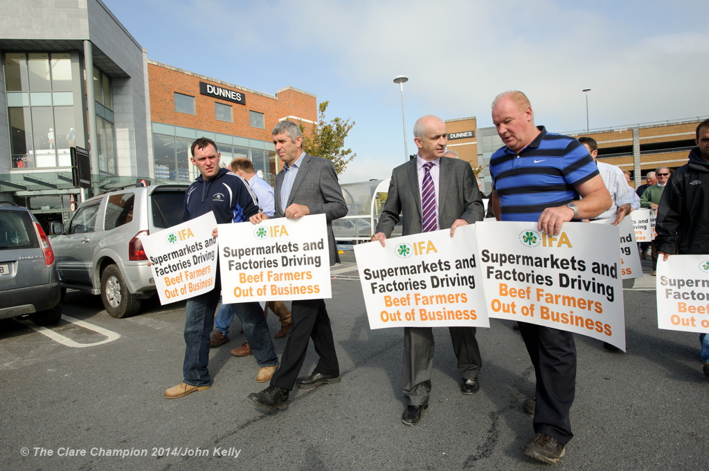 Clare IFA chairman Andrew Dundas and national chairman Eddie Dowling, centre,  marching with IFA members during the Clare IFA Beef price protest outside Dunnes Stores in Ennis as part of their national campaign. Photograph by John Kelly.