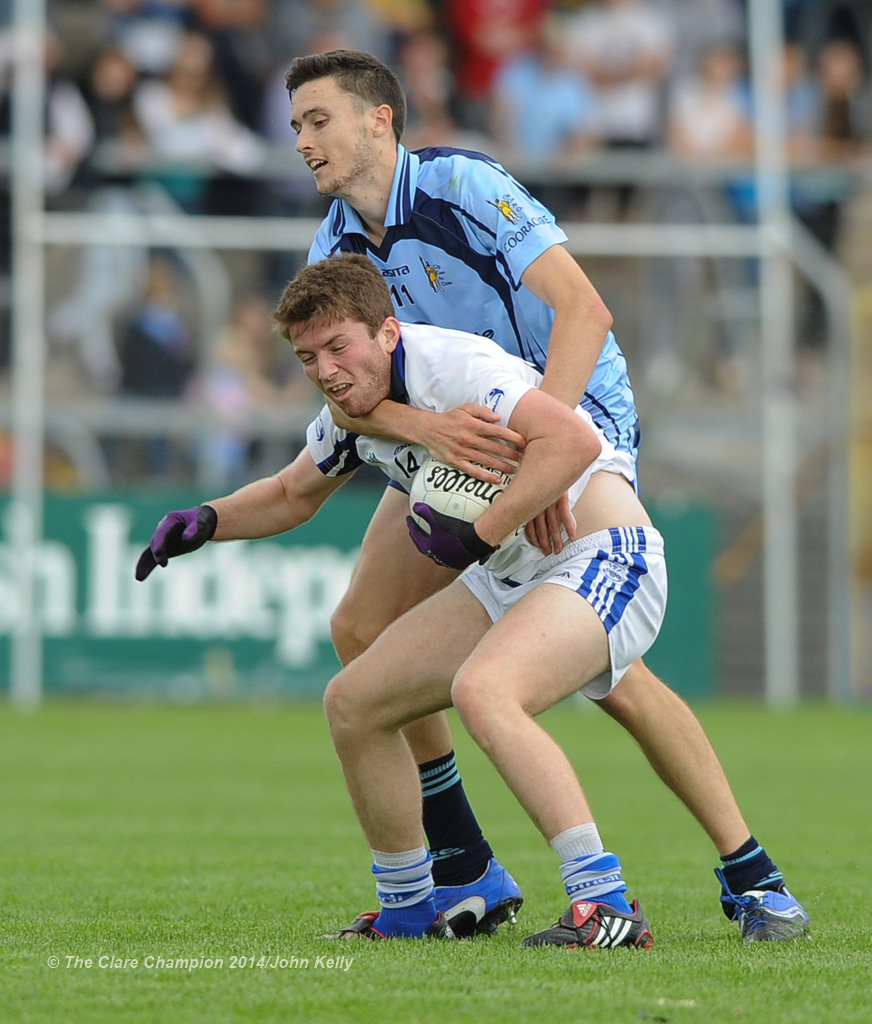 Cooraclare's  Damien Burke tussles with Cratloe's Cathal Mc Inerney during their semi final at Cusack park. Photograph by John Kelly.